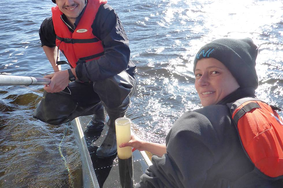 Ingmar helping Josefine to sample lake sediments from the floats of the float plane