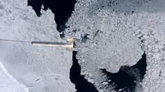 The AWI sea ice thickness sensor EM-Bird during a measurement flight across arctic sea ice in spring 2009. This aerial photo taken was with the IceCam camera onboard the German research aircraft POLAR 5.