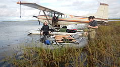 Josefine, Jim Webster and Ben Jones installing the lake sediment coring platform in the Kobuk river delta