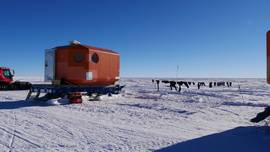 "Sunny day at ""Oldest Ice Reconnaissance"" field camp in Dronning Maud Land. Drying laundry and sleeping cabin."