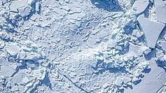 Arctic sea ice. This image was taken with the IceCam, installed in the hull of the EM-Bird, the AWI sea ice thickness measuring sensor, which in pulled underneath a helicopter above the sea ice to measure its thickness. The camera points vertically downwards and takes photos of the area directly underneath the bird.