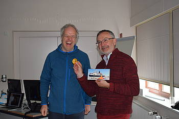 "In thanks, Hartmut Heinrich received a small ""award"" as well."