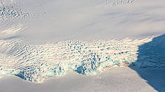 Aerial image of a glacier's calving front on Spitsbergen. This photo was taken during the NETCARE campaign in spring 2015.