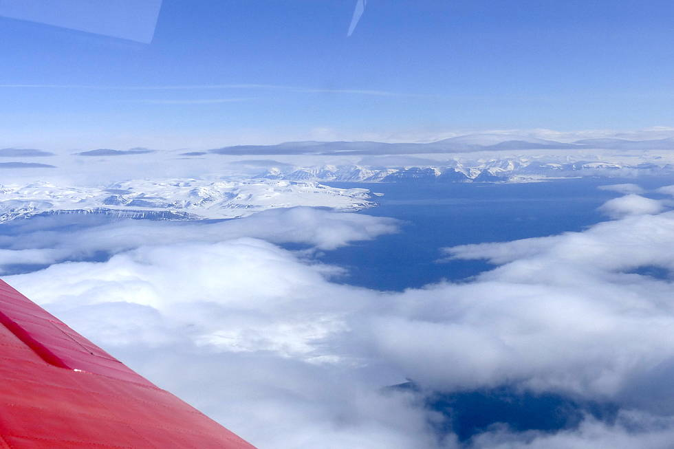 Clouds over Svalbard during a flight of the Polar 5 aircraft on its way towards  the measurement region over Fram Strait during ACLOUD.