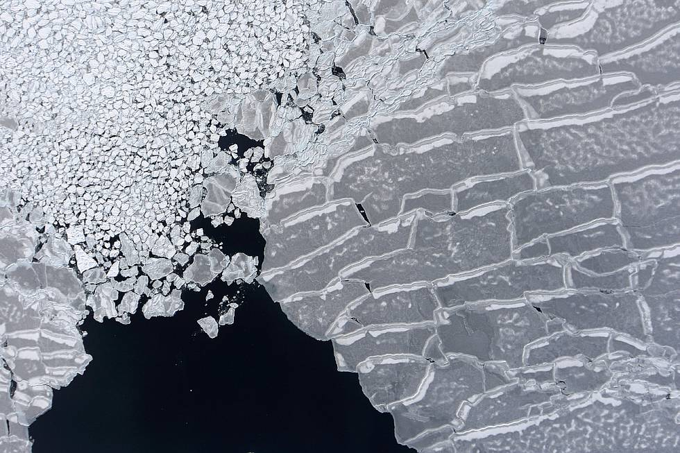 Aerial photo of Arctic sea ice. The photo was taken with the IceCam camera onboard the German research aircraft POLAR 5. This image was taken during the PAMARCMIP sea ice measurment campaign in the year 2009.