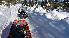 Returning back from the field by skidoo