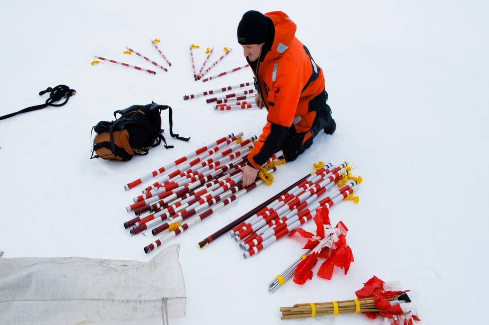 AWI sea-ice physicist Christian Katlein is sorting equipment, which he wants to use for ROV measurements below the ice.