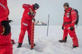 First group of scientists lands on an ice floe. Gunnar Spreen (l) and Matthew Shupe (r) exam a potential ice floe for MOSAiC. September 30, 2019, Esther Horvath