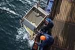 Polarstern crew members pull a multi net onboard. It consits of five nets, which are used to catch zooplankton in five different horizons of the water column. Photo: Alfred-Wegener-Institut/Sebastian Menze