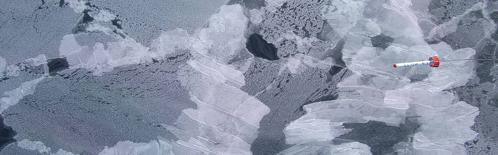 The AWI sea-ice thickness sensor EM-Bird  over thin ice: The picture was taken with a nadir-looking camera that was mounted inside the MI-8 helicopter. It shows the EM-Bird 15 meter above a layer of rafted thin ice, approximately 10 centimeter thick.