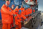 Pure joy about a successful sediment core recovery: Polarstern expedition leader Rüdiger Stein (blue hat) and his team are posing next to the box core. Photo. Alfred-Wegener-Institut/ Audun Tholfsen, UoB