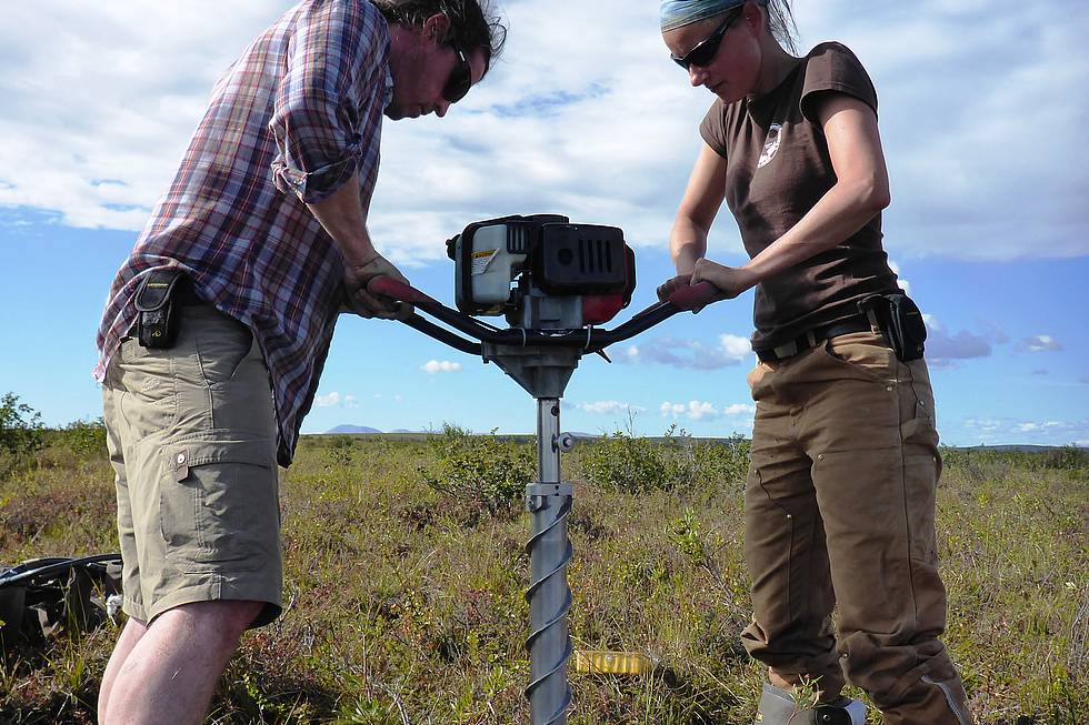 Ben Jones and Josefine coring permafrost with the SIPRE corer in the Noatak Delta