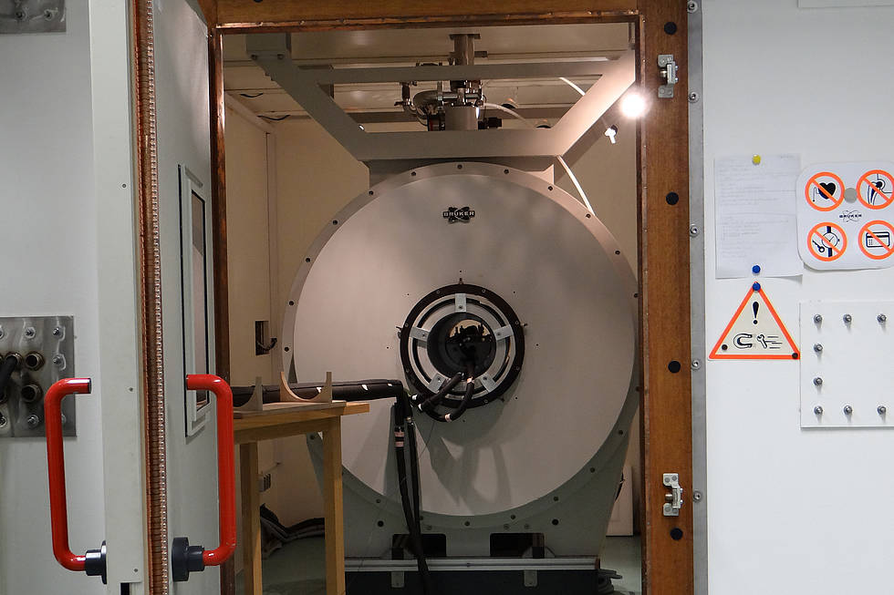 The NMR system is enclosed by a protective chamber.
