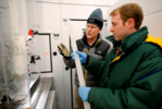 Joe McConnell, Ph.D, the study's lead author, and Nathan Chellman, a doctoral student at DRI and coauthor on the study, examine an ice core in DRI's Ultra-Trace Ice Core Chemistry Laboratory in Reno, Nevada.