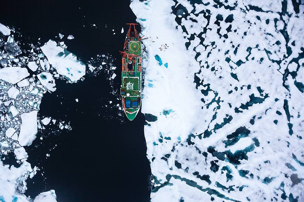 The German Research vessel Polarstern during an ice station in the Arctic Ozean. This image was taken with the IceCam, installed in the hull of the EM-Bird, the AWI sea ice thickness measuring sensor, which in pulled underneath a helicopter above the sea ice to measure its thickness. The camera points vertically downwards and takes photos of the area directly underneath the bird.