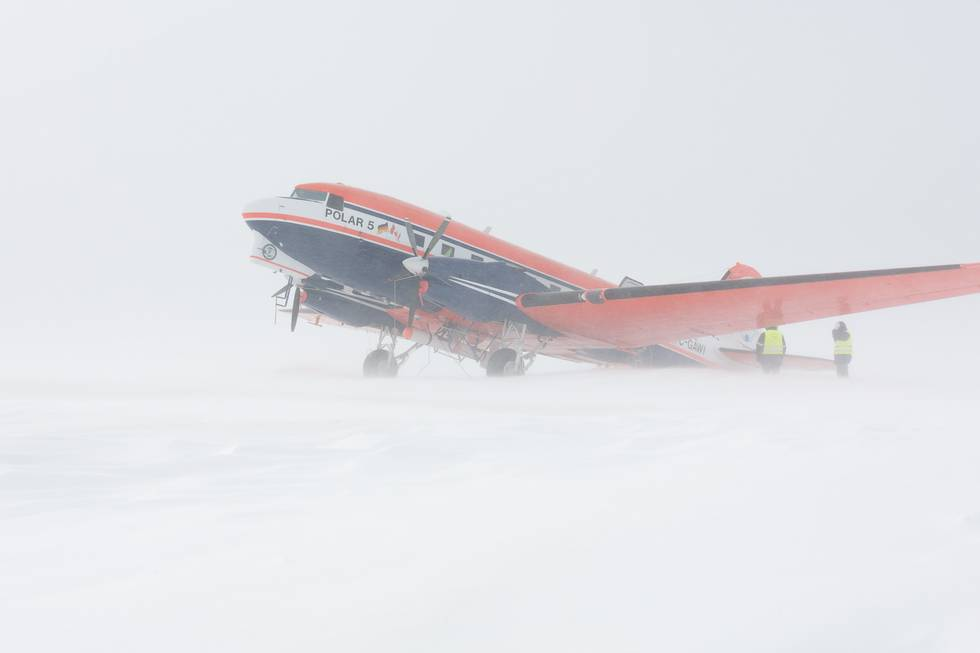 Snow drift form around Polar 5 while equipment is loaded into the airplane. This photo was taken during the NETCARE campaign in spring 2015.