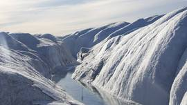 A melt water river on the surface of the Russell glacier.