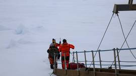 First Team goes down the gangway of Polarstern onto MOSAiC Floe Fortress during MOSAiC Leg 4 to explore the ice conditions of the floe