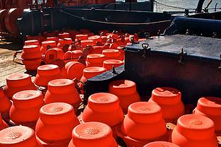 Dozens of buoys are needed for the moorings, which are up to 2 500 metres below the water's surface. To prevent their becoming tangled during deployment, the researchers and members of the ship's crew first spread them out on the deck of the Polarstern.