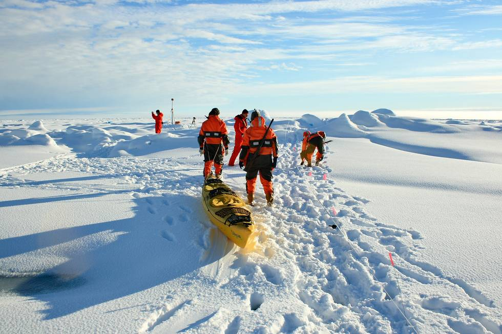 The electromagnetic sensor EM-Bird is drawn for the ice thickness measurements in a canoe on the sea ice.