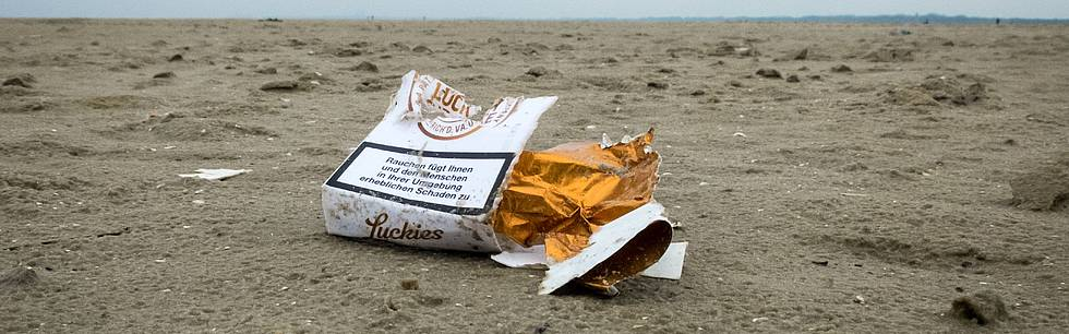 Litter washed ashore at the beach of the German coastal town St. Peter Ording, North Sea.